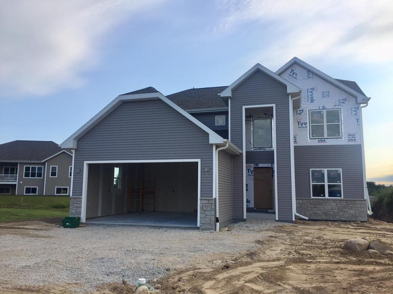 Planned to be completed by the end of 2019, this stunning two story 3 BR, 3 BA home will not disappoint!  To be finished with qualify custom cabinets, granite counters, luxury SWFs ,  and built-in sound system are just a few of the many upgrades.  Home features 9 ft ceilings on the main level, grand 2 story foyer, formal DR, huge LR with open kitchen with large center island and walk -in pantry.  Upstairs has MBR w/gorgeous MBA and WIC.  Lower level is partially exposed with large windows.  Built with 2x6 construction, fully insulated and drywalled garage, R50 insulation in the home  and much more.  Be the first to own this quality built home located in a cul-de-sac with great views and close to schools and shopping.  Taxes are estimated.