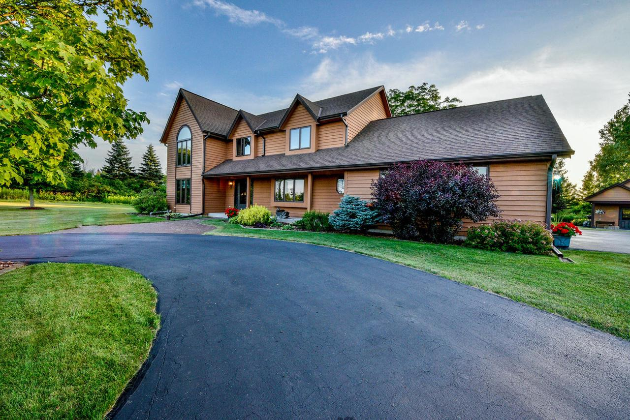 Location, Location, Location....This is a must-see rare opportunity on Lake Shore Rd located on the prestigious side of Grafton with Lake Michigan view and within walking distance to the enchanting Lions Den Gorge Nature Preserve. This 4-bed, 2.5 bath home is on 2+ park-like acres with fire pit, horseshoes, 20'x25' paved patio with walkway, lots of privacy and room to entertain. Available features include; natural fireplace, hardwood floors, vaulted and cathedral ceilings throughout second level, 3 Pella skylights, built-in bookshelf in upper foyer landing, custom out-building with maintenance free hardi-plank siding and 100amp electrical service with separate meter from main dwelling and so much more...Come and see what this home has to offer!!!''List of Features'' located in Documents