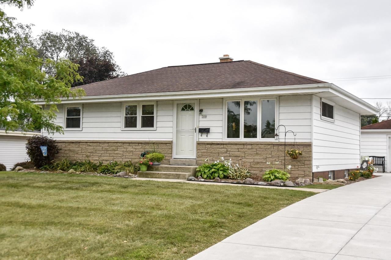 Get ready to call this one home! This adorable Grafton ranch welcomes you with it's bright, sunny living room and spacious kitchen filled with an abundance of cabinet space and new stainless steel appliances. Three bedrooms on the main level, complete with hardwood floors and new windows. Lower level is freshly remodeled including a full bath and is just awaiting a few finishing touches to round out your new family room and wet bar! New patio and driveway with a beautifully landscaped private backyard is ready for you to enjoy on the crisp Autumn evenings to come. Don't delay!