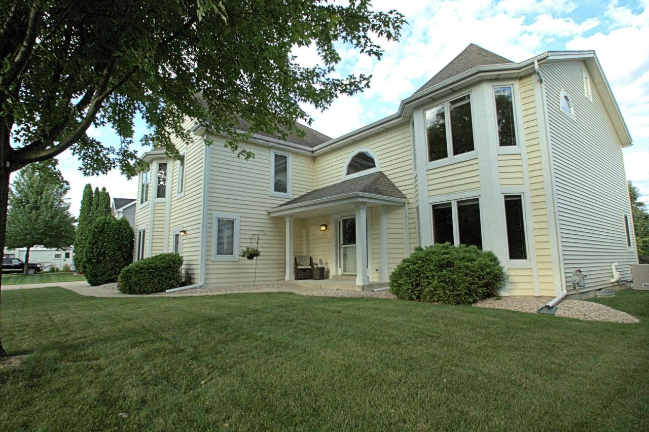 Hard to find multi-generation contemporary home with bonus upper level studio suite. Vaulted great room has skylights, natural gas fireplace, new hardwood floors. Open floor plan.  Kitchen has newer stainless appliances, wall pantry & refinished hardwood floors.  First floor newly carpeted master offers whirlpool tub, new walk in acrylic shower, double sink vanity and ceramic tile floor.  3 Bedrooms with newer carpet and updated full bath on upper.  Finished lower includes half bath, bar and media area for family gatherings. First Floor Laundry. Sliding doors to bluestone patio, gas firepit, & manicured fenced yard.  Private entry suite over garage has full kitchen, living room/gas fireplace, whirlpool bath & stackable washer/dryer. 2018 siding. Close to schools, parks, golf, public pool .