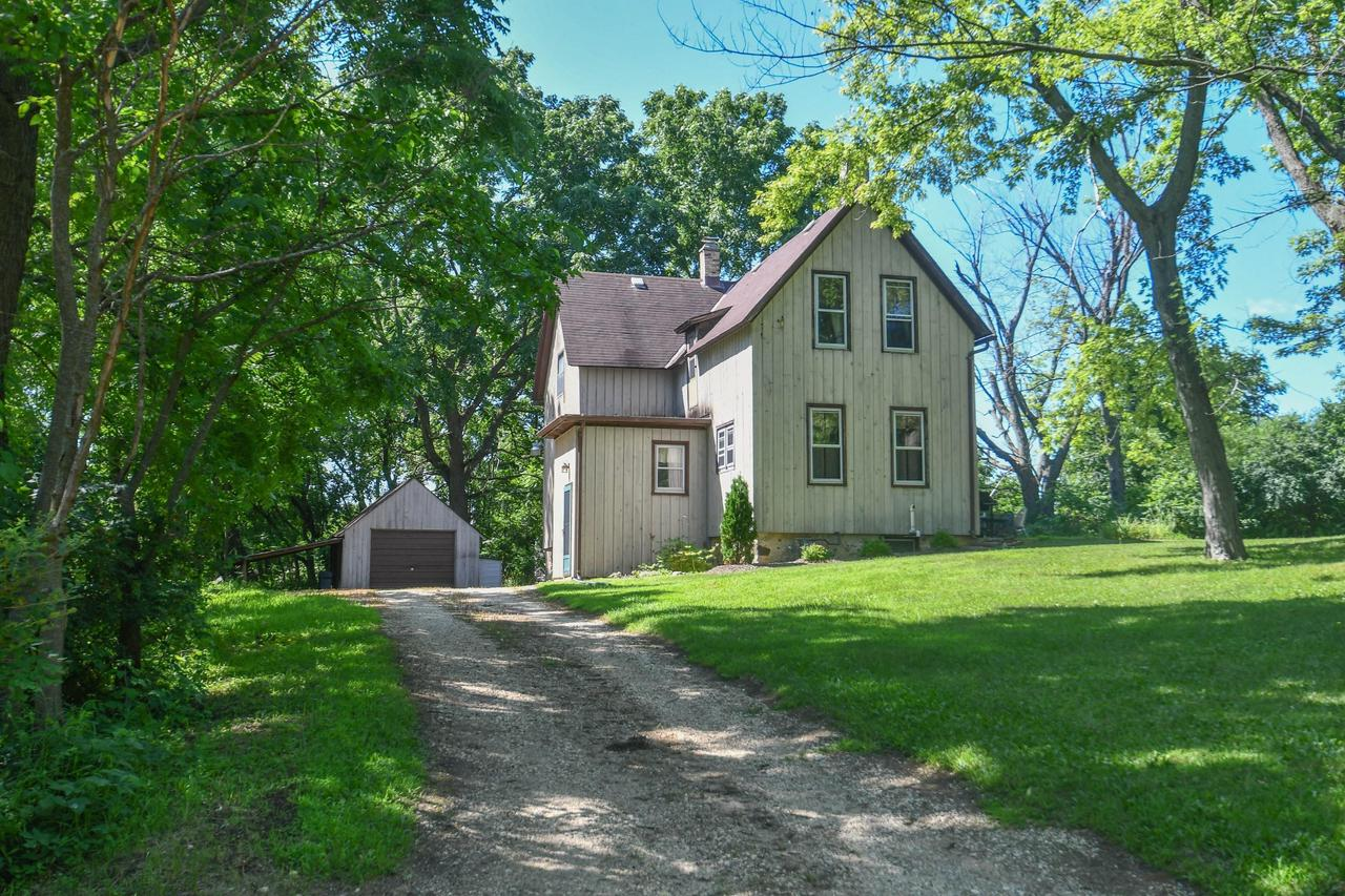 Incorporate the treasures of your life into this timeless 1900 farmhouse situated on a wooded lot that is over an acre.  The large sunny eat-in kitchen lead to an outside patio though sliding doors. High ceilings, living room, den, & convenient 1/2 bath finish off the main floor. Upstairs features a very spacious master bedroom, full bath, 2nd bedroom, & office that could easily be used as a 3rd bedroom.This is a must see!!!