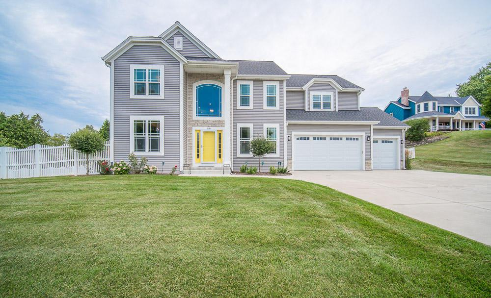 Stunning 4 bedroom 2.5 bath colonial home with a 3 car attached garage. With a gourmet eat-in kitchen with staggered cabinets, island, and stainless steel appliances. Large dinette area with patio door to a concrete patio area over looking a fenced in yard. Tray ceiling in formal dining room. Bonus room/office. 1st floor laundry.  Over sized MB with on suite with his/her vanities, tub and walk-in shower. 3 Additional spacious bedrooms with plenty of closet space that share a full bath with double sinks.  Loft over looking large LR with stone FP.  Bring your ideas to complete the LL. Easy access to Hwy 43, Hwy 60. Located near shopping, restaurants and downtown Grafton.