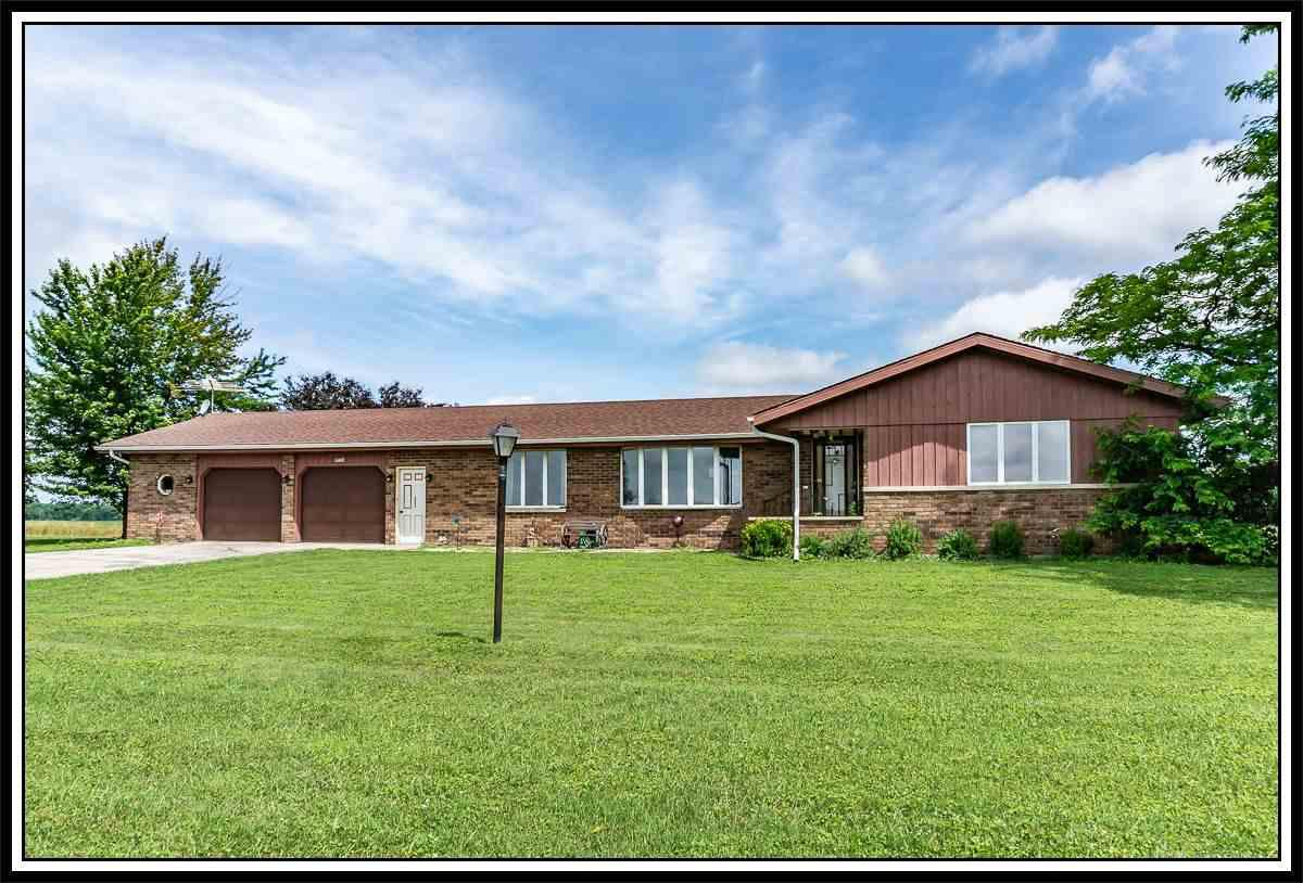 TRANQUILITY, WILDLIFE & UNDER $180,000 - 3BD/2BA Ranch on 1.3 Acres boasting Bright, Sunny Living Room w/FP, Formal Dining Room w/built-in Cabinetry, SPACIOUS Kitchen w/Cabinets Galore, Office Drop Area & dining area to concrete patio for all of the summer BBQs & 'Binocular' action!  Large Master Bedroom PLUS 2 ADDT Bedrooms & TWO (2) Full Baths!  NOT ENOUGH ROOM??? Bring your plans and finish off the lower level - FANTASTIC BASEMENT!!  ATT 2.5 Car Garage/WORKSHOP PLUS ADDITIONAL STORAGE SHED!