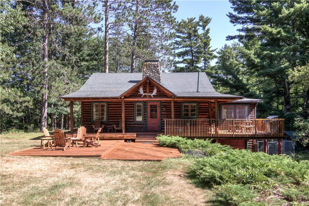 This rare northwoods paradise with 58 acres of forest and 2 lakes could be yours. Over 1000 feet of frontage on Phipps Lake plus another 1100 feet on a private lake. Peace and Serenity in this well maintained authentic log cabin. It was featured in Cabin Life magazine! Read a book or take an afternoon nap in the classic cabin porch room. Enjoy every kind of outdoor activity...swimming, kayaking, hunting, hiking, and XC skiing just out your door. All this, and it?s all only 5 minutes from Hayward!