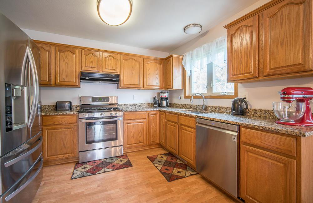 This amazing property has the feel/space/privacy of a single family home, but MUCH cheaper taxes!! This beautiful side-by-side has everything you could need. An eat-in kitchen with granite counter tops, new flooring and new stainless appliances. A huge family room with new light fixtures, a gas fireplace, and even a private first floor deck. Main floor utility/laundry room next to the remodeled half bath. Head upstairs for two of the three bedrooms. One which has a giant walk-in closet, the other has two closets, both have their own full bathroom! Down in the walk-out basement is the third huge bedroom, another full bathroom, and a rec-room/office space looking out at the patio and natural nature area w/creek. A condo like this is rare! Call today to book your private showing