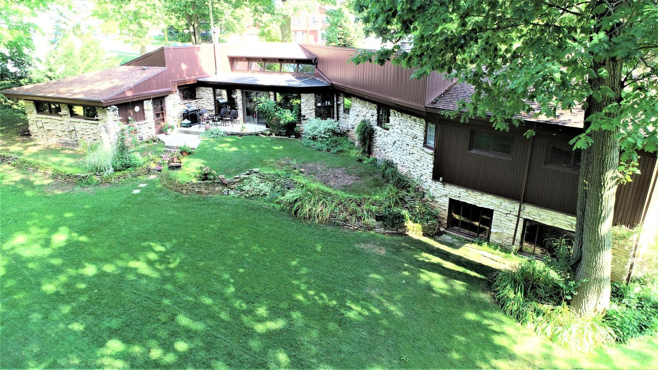 Stunning lannon stone contemporary open concept ranch on .43 acres with towering oak trees in a park like setting.  Enter the new front door to a tile foyer that leads to a open living room w/GFP  & family room area offering massive windows,wood burner  & dormer windows facing south-WOW! Large working kitchen with lots of cabinets & semi formal dinette. Huge master bedroom with walk in closet. Full bath fully updated tile floors, SOT whirlpool! 1st floor laundry. Two other  bedrooms with large closets and 2nd full bath.  Lower level rec area offer lots of possibilities!  Huge private back yard!  New roof 2013 (tear off) , Zoned heating (in floor and registers), some new windows.  Lower Rec room possible workshop  offers  exit door to outside.PLEASE READ HOME INSPECTION REPORT.