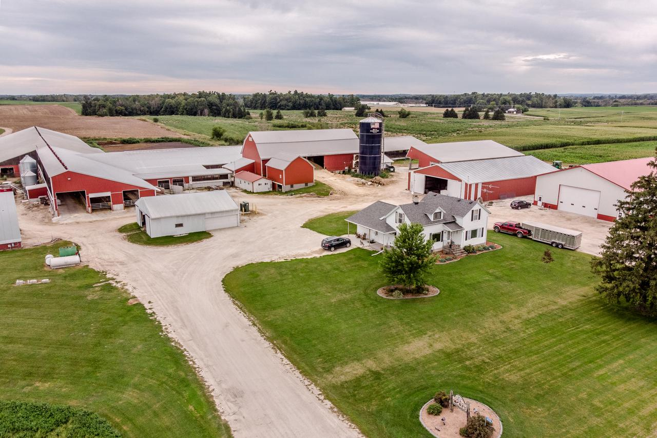 This is One of Wisconsin finest Dairy facilities .  In the family since 1879 , and now being operated the fifth generation.  The current operation  of 550 cows  is milked in a Boumatic double 8 parallel     parlor. Parlor measure 40 x 40 with a 40 x 100 holding area.  There are two bulk tanks one 4000 gallon and one 6000 gallon.  All barns are insulated  with side curtains, mats , panel fans,  75 baskets, and sprinkler systems.  552 free stalls and 517 head locks . Breeze way 16 x 100  features loading docks  for pot belly trailers and goose neck.   There is a separate area for hoof trimming  and cow brush.  3 -  30 x 100 feed bunkers, 2 -25 ton feed bins and 1 -12 ton feed bid and 120 x 120 cement pad for additional feed. There is 3--phase on the farm.  Home offers 5 bedrooms 1 3/4 bath, r
