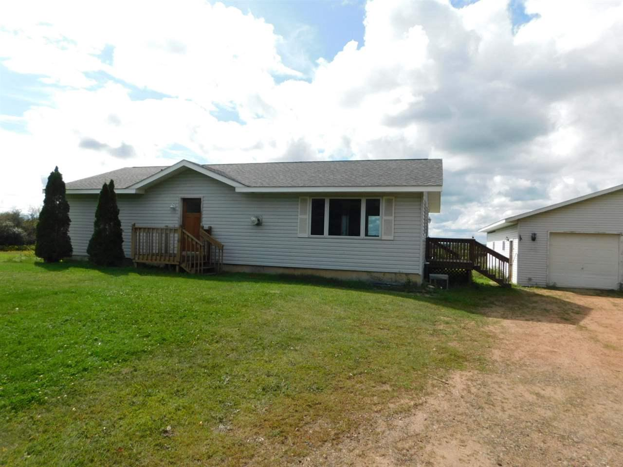 17 year old 3 bedroom, 2 bath home, with gas fireplace in living room, deck off dining and main floor laundry. Full basement, with high ceiling for potential of finishing. Double deep garage, all set on 20 acres, partially wooded, east of Merrill.  Seller will allow for a new roof in the price.
