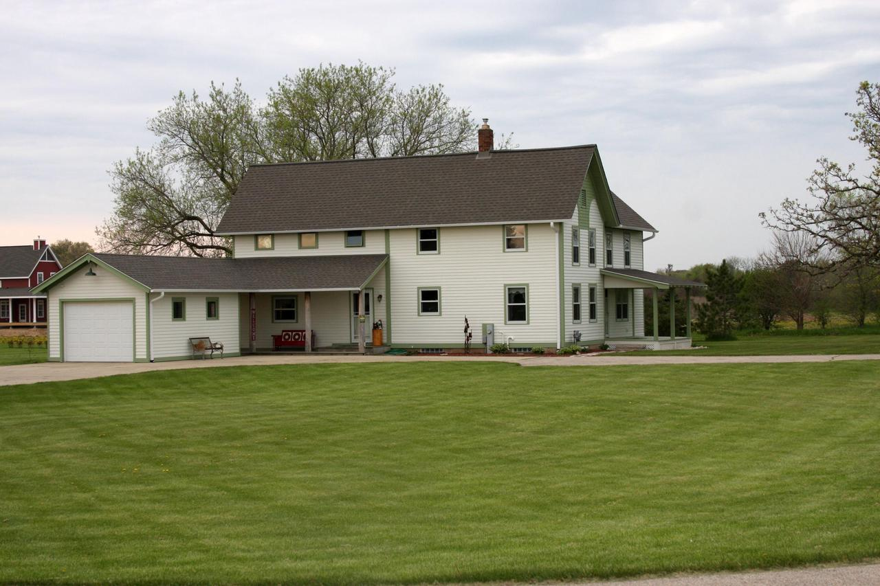 Your own piece of heaven is waiting in this 5 acre hobby farm. The picturesque grounds and freshly painted home will make you not want to leave. The updated kitchen with new cabinets, marble island, and heated floors is large enough for any gathering. Enjoy family dinners in the dining room or relax in the inviting living room. The master bedroom offers a well appointed bath and walk-in closet. Horseshoe pit, fire pit, and pergola have perfectly planted trees to allow shade in the hot summer months & gorgeous perennial beds compliment the exterior. Outbuildings include a huge, insulated, heated shop with upgraded electrical. A 2-story barn offers endless possibilities - horses allowed. A car collectors dream with parking for at least 10+ cars. Home warranty included too.