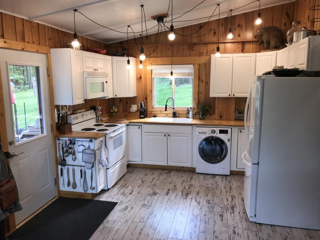 Completely remodeled inside and out to the point of being a brand new year round cabin.  LP sided with Galvanized wainscoting and a patio area with stonework gives it great curb appeal from the road and from the lake.  A great view of both and a firepit.  Inside is all down with weathered wood looking floors, modern kitchen, and 2 fireplaces.  Every inch of this place has been gone through and every inch has been maximized.  This is a true gem.  The view of the lake can be enjoyed from all living areas and especially from the 4 season porch.  Great lake access with new stairs.
