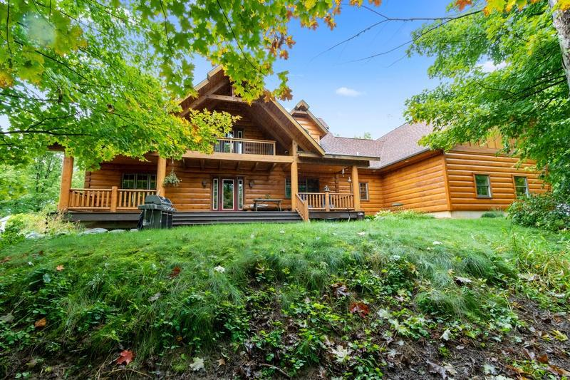 Magnificently crafted this impressive true east Canadian white pine log home is spacious and well designed.  From the 20? wide grand front entrance, to the 1500 sq ft deck, to the master suite with covered balcony, walk in shower, and hand crafted railings, this home is sure to please!  Pine plank flooring in the kitchen with alder cabinets, main floor laundry with huge mudroom, and a large 3 car garage with stairwell to 2nd level.  Office with double glass doors right off the front entry perfect for an in home business/office.  Lower level has in-floor heat, a secret hiding room, and possibilities of a mother in law apt.   R2 zoning allows residential living or the possibility of a retreat center, wedding venue, or other various opportunities.  Conveniently located on a dead-end street near Hwys 8 and 35 and next to the bike trail. City utilities with 7 acres of privacy and space.  A solid home for a great value; call to schedule your private tour.