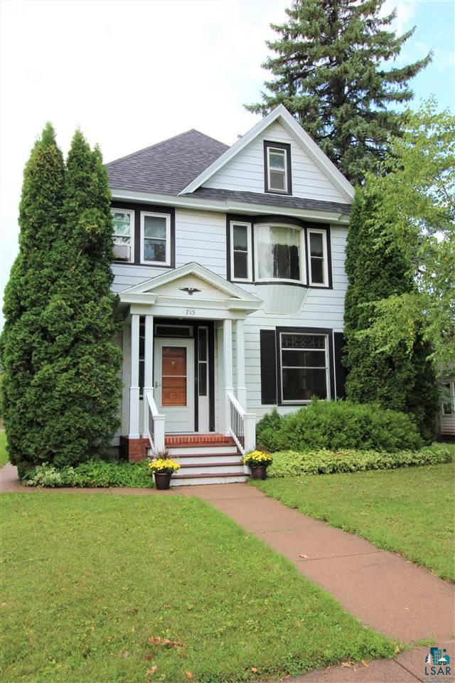 "Beautiful Victorian home in the heart of Ashland with original character and craftsmanship throughout. This well loved and well maintained four-bedroom, two-bath home has a three-car detached garage and comfortable updates. Everything about the home feels ""just right"" with a spacious entryway, grand staircase, formal living room and dining room, wood burning fireplace, bright kitchen that leads to an outdoor deck, yard & gardens.  Hardwood floors, high ceilings, leaded glass, cork flooring in the kitchen, crown molding and intricate wood carving are just some of the craftsmanship you'll find throughout. The master bedroom has a special room that can be used as an office or nursery, bay window and large closet. A full basement and attic provide plenty of storage space. Here's your chance to own a lovely historic home that you can move right into and enjoy living just blocks away from downtown, Lake Superior and Northland College."