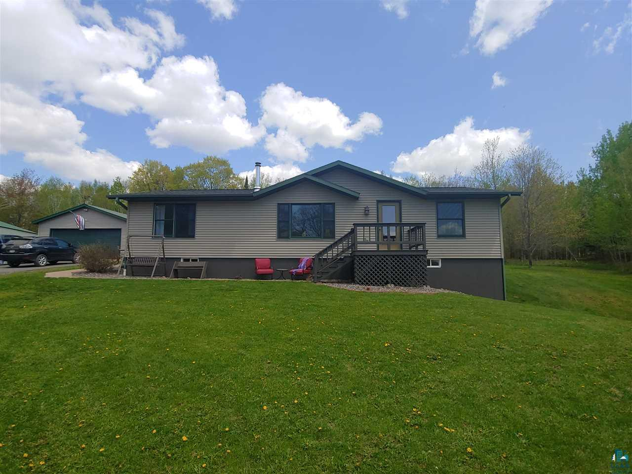 Beautiful turnkey three bedroom three bath home (Stratford 2002) on a dead end road all on 5 acres Quiet no traffic setting with an incredible view. Only 10 short minutes to Ashland or Washburn, Forced Air Heat and Cooling,  Cozy Wood Stove in Living Room and Electric Baseboard additionally in the basement, Open Concept, Updated vinyl flooring Finished basement with walk-out, Main floor and basement laundry. Heated garage and workshop(24x40)  Steel pole building(30x48) with a concrete floor and loft provides plenty of space to storage your equipment and toys.  Available renters for the pole building if you don't require all the space.  Come check out what this property has to offer.