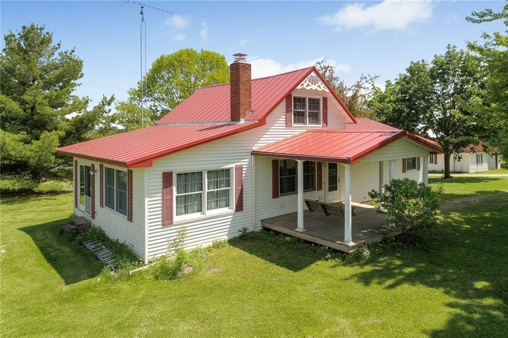 Here's your chance to own a piece of Wilson, WI history! The property was homesteaded in 1865.  Clarence Jacobson bought the home in 1918. Current owner has lived here for 49 years (purchased fully in 1986 from the family) Living & dining rooms share the view of the original fieldstone fireplace. Yes, Real fieldstone from this farm. It's in great shape! Fireplace has a heatilator. 2 other water hydrants on the property.  Please see the attached amenities sheet for extra buildings & updates.