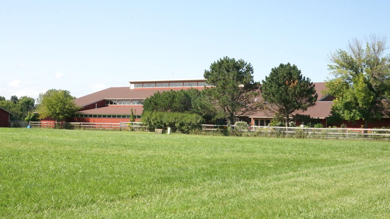 Impressive Equine Facility on aprox 28+ Acres. 155 x 70 Indoor arena,14+ Box stalls approx (10x12 )with Automatic waterers. Stall area has Heater and 2 half baths. Addition barn with run in area plus storage area. Plus Barn with extra tall doors with huge storage plus run in area in theback. Most of the acreage is fenced with Automatic waterers in the pastures. The Spacious Ranch Home is attached to the barn. Generous Living room with sunroom. Open Kitchen/ Dining room area with peninsula for additional seating.Updated flooring throughout most of the Home. 3bedrooms, 2 full baths, 2 car garage. Huge viewing room. Office area has windows to the Indoor arena. Connects to the Caledonia Trail System.