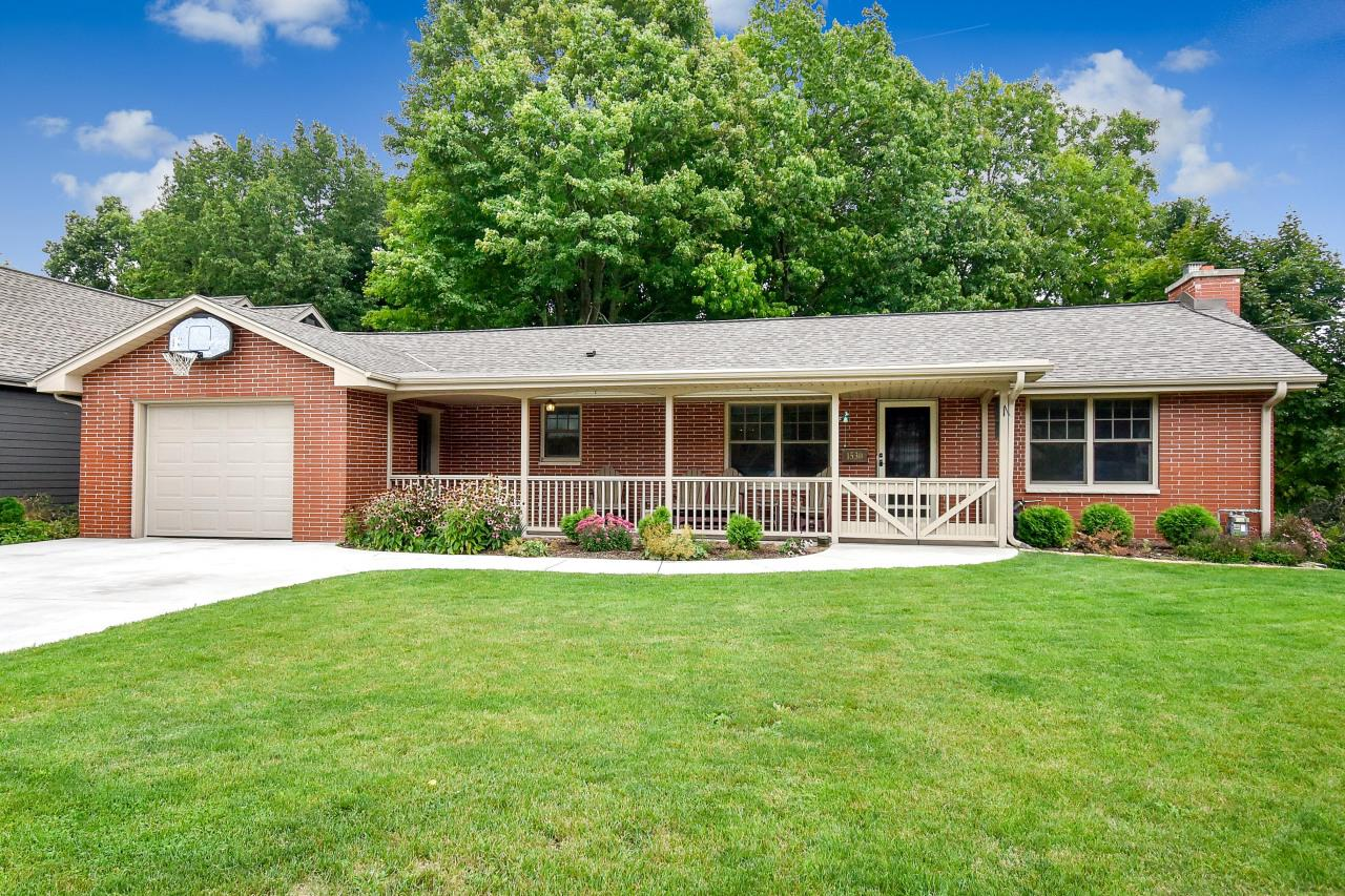This one has it all! Enjoy vacationing at home with lovely views and sounds of the Milwaukee River in your own backyard. This updated brick ranch w/ terrific curb appeal will be sure to please. The main floor offers HWF, wood-burning fireplace, stunning custom-built hutch w/ granite, spacious LR which leads to an enormous maintenance-free deck overlooking the river, built-in surround sound, top of the line Marvin windows & so much more. Watching movies, entertaining, and comfortable family living will be a delight in the LL FR w/ a gas insert fireplace, dry bar w/ custom birch cabinetry & granite counters, spacious BR, full BA w/ travertine & granite and a den/office area. Way too many features & updates to list. Even the driveway was replaced in 2016.  Updates & Improvements in documents.