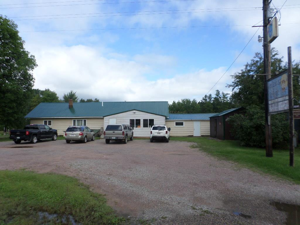 This is a local 1970+/- square foot tavern with attached 1000+/- 2 bedroom living quarters all for the price of each! The loyal customer base that say they stay with the business. The bar area is served by a 36' horseshoe bar plus there is a game room, walk-in cooler, kitchen and storeroom. 2 sets of horseshoe pits. Located on the border of Jackson/Wood counties it is on an ATV and snowmobile trail and advertised on several maps. This building was part of Hotel Jenson built around 1902. It has since been updated. This is an affordable operation and if you're looking for a business with community and customer support here it is!
