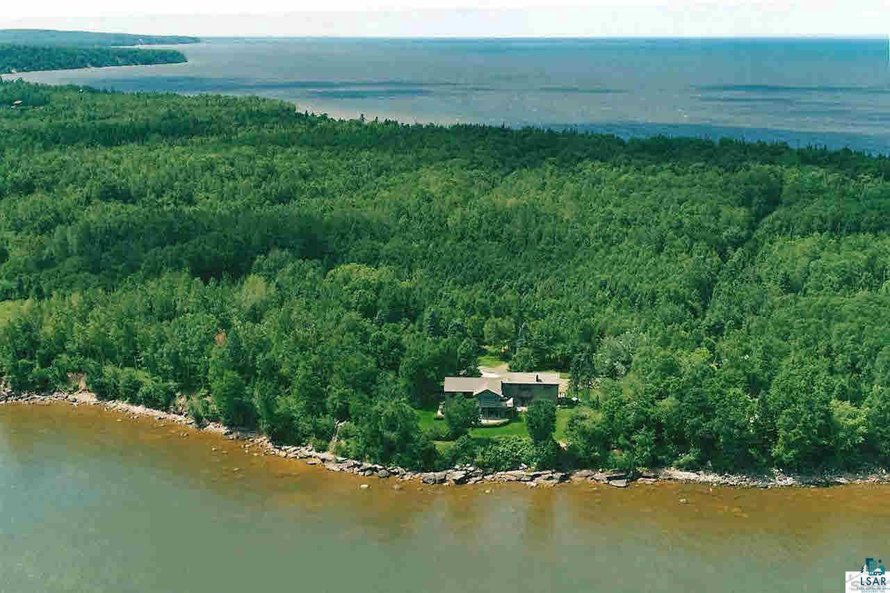 "Unique and quality built lake home on the South Shore of Lake Superior. The location is a talking point in its self...located near the very end of Bark Point which is a 7 mile peninsula offering a public beach and public camping near DT Herbster and public boat launch with small sand beach area near the tip of Bark Point only steps from the home. Bark Bay Slough a few paved miles away. ""Great"" room/open concept floor plan with spacious kitchen, dining and living room on upper level to grab the panoramic, spectacular views looking easterly toward Bayfield and 22 Apostle Islands. This home is perfect for arts and crafts enthusiasts with many rooms being versatile. Wood burning fireplace with nifty firewood elevator! Nicely landscaped, decks on each level, screen porch upper deck, views and views"