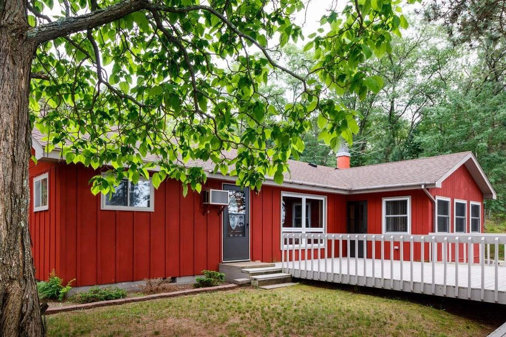 This comfortable and welcoming year round cabin offers 1960s charm with plenty of character on premier Bond Lake. One of Wisconsin's top 10 clearest lakes with 20' of clarity and 150' of sandy lake frontage. Includes garages, large workshop, and bunkhouse. 3rd bedroom in lower level (non-conforming). Large living room with massive stone fireplace and gorgeous lake views from most rooms. Western exposure. Can be purchased as multi-family property; adjacent cabin is also for sale. Don't miss.