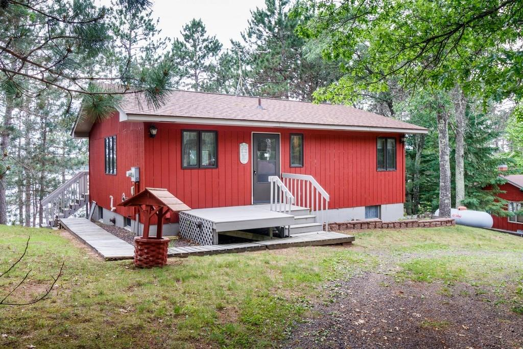 This comfortable, welcoming, and affordable year round cabin on premier Bond Lake. One of Wisconsin's top 10 clearest lakes with 20' of clarity and 120' of sandy lake frontage. 2-car garage. Large living room with gorgeous lake views. Western exposure. Can also be purchased as multi-family property; adjacent cabin is also for sale. Easy 2.5 hours from Twin Cities or 1 hour from Superior/Duluth. Don't miss.