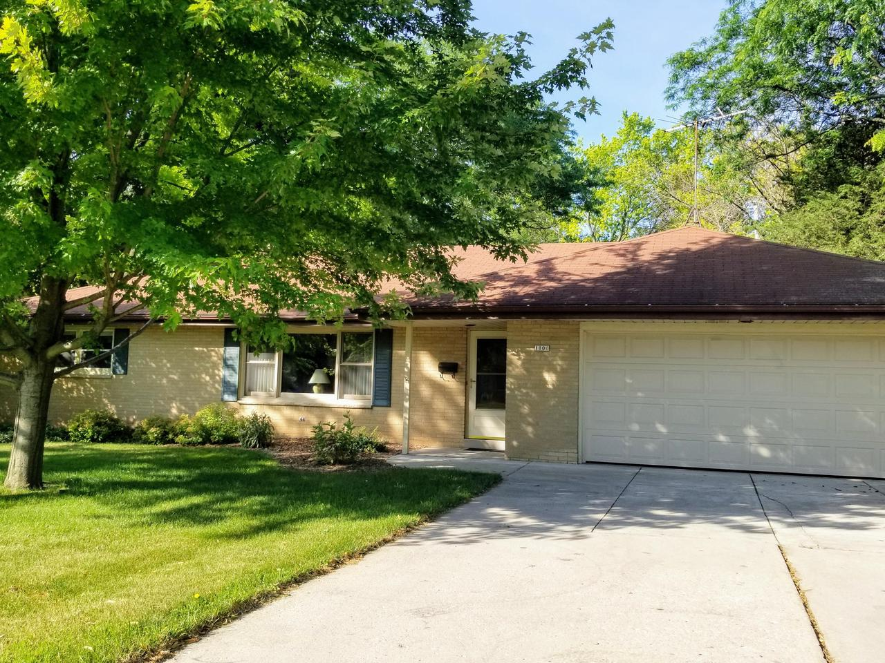This all brick  ranch  home has a comfortabe floor plan!  Large sunny living room w/crown molding,  opens to the dinette and adjacent kitchen work center.  There is a cozy famrm/den area too!  Three bedrooms have HWF's.  A 2.5 car attached garage,full basement for your own finishing touches all wait your viewing!,