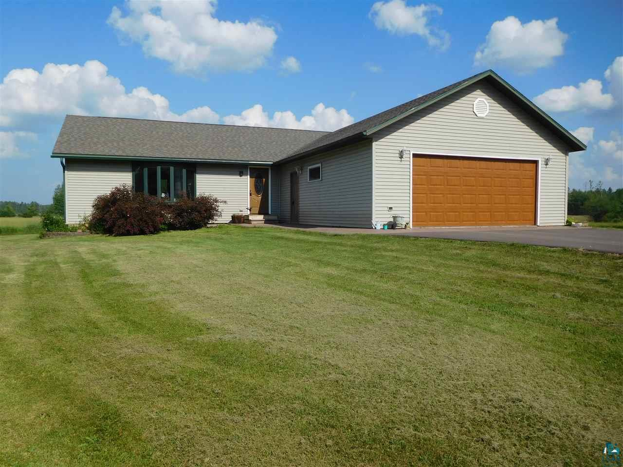 Four bed, three full bath, two-car garage country Ranch home within ten minutes of Ashland and the beaches of Lake Superior! Enjoy main level living and a completely finished basement that includes a bedroom suite, full-bath, bar and living space for fun and recreation. The main level contains a master bedroom with attached full-bath, soaking tub and walk-in closet, two more bedrooms, living room, kitchen and dining room with sliding doors that lead to the deck, a laundry room and mud room.  The deck offers beautiful sweeping views of your five acre yard and the surrounding countryside. Two sheds are conveniently located next to a large fenced-in garden area. New roof in 2017, new drive-way in 2018, new carpet in bedrooms, new flooring in laundry room, heated attached garage and new garage door are a few of the updates.  Move right in and enjoy country living within minutes to the city!