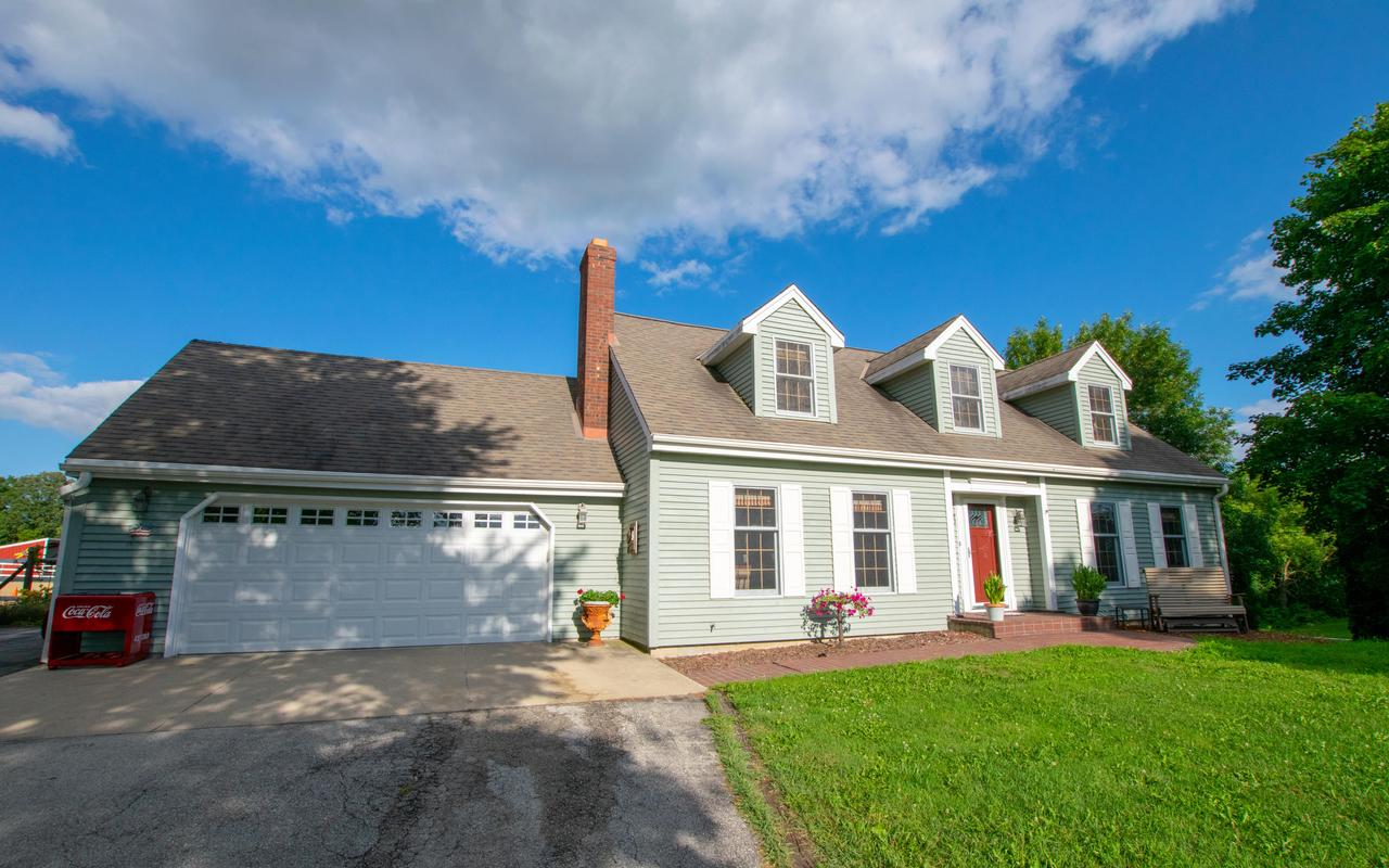 A true horse lover's paradise! Beautifully updated cape cod on 10.5 picturesque acres in the Town of Jackson. Completely renovated outdoor spaces/barn in 2015. Heated, insulated barn includes 7 stalls (6 padded), hot water, wash stall, and directly connects to 80'x60' indoor arena for comfortable access in even the worst winter conditions. 4 paddocks (2 w/ dry lots), 4 run-ins, new horse fences, huge grassy pastures, trails for riding/hiking, and 150'x90' outdoor arena. Separate 40'x30' hay/storage barn w/ concrete flr. Serene, fully fenced yard includes brick patios, lush plantings, pergola, and elevated ''treehouse'' deck for relaxing. Stunning home incl. updated WI Kitchen Mart kitchen, hardwoods throughout, LL walkout w/ 4th bedroom option, and quality character everywhere! See video!