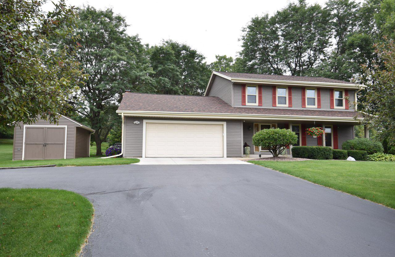 This is a must see four-bedroom colonial home located in a small quiet neighborhood! Conveniently situated between both downtown Grafton and Cedarburg. Well maintained and full of pride in ownership throughout. Features include custom built kitchen with beautiful cherrywood cabinetry. Convenient first floor laundry. Master bedroom has en suite bath. You will also find plenty of storage. Private backyard with large deck is perfect for entertaining! this home has great curb appeal and is ready to move right in!!