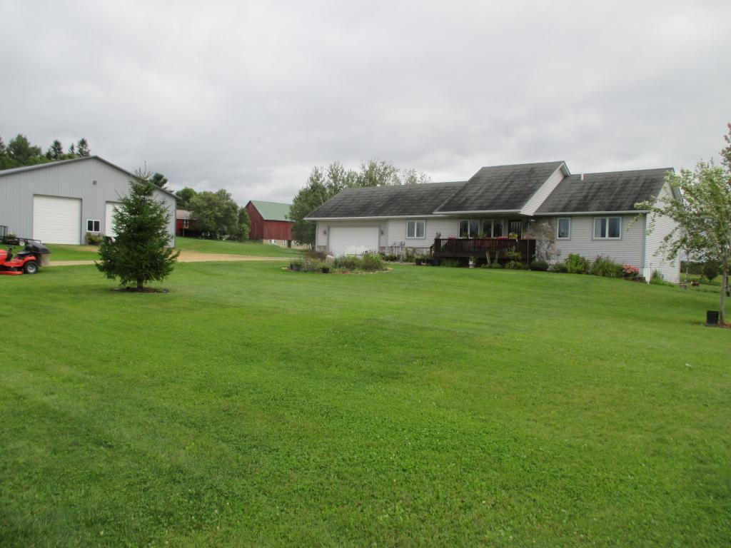 Gorgeous home on this 30.29 hobby farm. This lovely, 4 BR home has custom cabinet, ceramic and wood floors, large deck, huge family room and main floor laundry. A 50x90 newer pole barn with 2/3 concrete floors awaits for storage and work shop. The 30.29 acres has about 16 tillable acres and fenced pasture for the animals. Location is close to I-94 and or a quiet side road