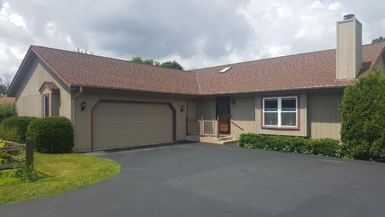 Updated 3 Bedroom 2 Bath Ranch, 1st Floor Laundry, Open Concept Living Room (NG Fireplace) and Kitchen (Granite Counter Tops) (SS appliances) with cathedral ceilings, Master Bedroom has Walk In Closet with attached Bathroom, 5 Hunter Ceiling Fans, Large Lower Level Rec Room, Fresh Paint, Attached 2 Car Garage w/ EDO, New Furnace and AC, Beautiful Yard with Deck in back yard & shed. Call today for your private showing.