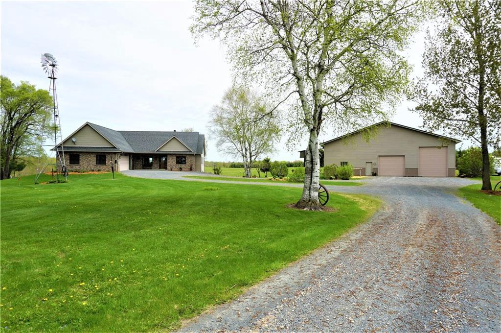 """Perfect Hobby Farm set up on 10 acres! (more acres available) Custom built 4 bdrm - 3 bath walk-out home w/ 2-1/2 car attached garage + 40 x 60 shed w/ 15x30 heated shop & RV parking. Fenced pastures for cattle or horses. Windmill will stay! Central Vac, 4 zone heating, central air... Home has """"spray foam"""" insulation. Main level office or 5th bdrm. Wine Cellar. Large Master Suite has tray vault, full bath w/ separate shower & whirlpool tub, & walk-in closet. Walk-in pantry. Marvin windows."""