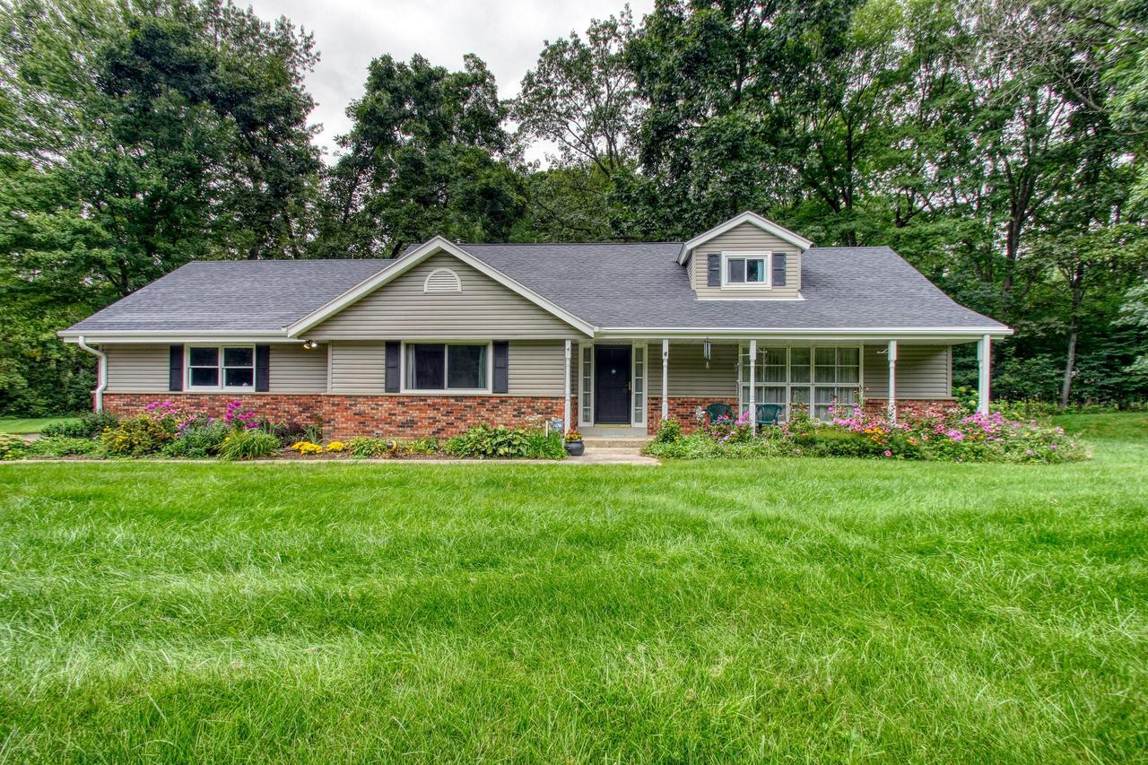 Spacious Erin cape- come for the livingspace, stay for the beautiful, mature rolling lot! Numerous updates! First floor master w/double size closet & a 2nd. Spacious & graceful livingrm w/dining L leading to bounteous kitchen featuring planning desk, granite, ceramic tile and massive bay window overlooking private, tranquil yard. Familyrm retreat w/fireplace, wetbar, & expansive windows perfect for birdwatching! Upper level features 3 sizable bedrms w/huge closets, roomy full bath, tons of storage space, & unfinished secret bonus room just waiting to be explored. Unique lower level  is panelled in barn boards with a matching built in bar, goes on & on, including numerous storage areas. Don't miss out on this beautiful almost 3 acre lot offering you peaceful & tranquility!