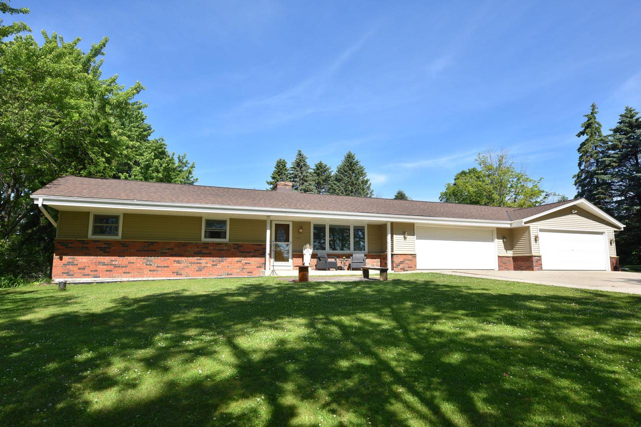 Sprawling split ranch set on an acre & convenient to everything!  Living room, family room & dining room with hardwood floors surround spacious & updated kitchen with views of back yard & enticing inground pool. One wing of the home offers 3 bedrooms & 2 full baths. Private Master wing adjoins first floor laundry, powder room along with large full master bath, walk-in closet & patio doors to outdoor patio & pool. You will appreciate the long list of improvements - 2016 roof, new Pella windows, newly painted throughout, new well pump & tank, 2016 water heater, new granite counters & backsplash in kitchen. Newer Appliances included!  Garden shed & 4 car garage will be a favorite for the guys. Home resides in Town of Grafton but is available for village annexation. UHP Warranty for next owner