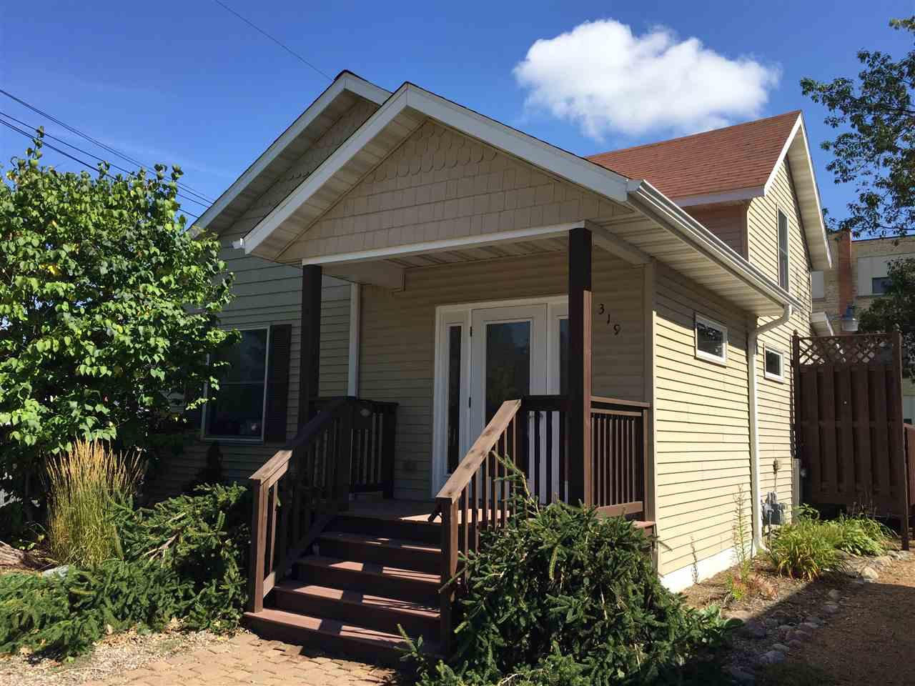 HOME OR OFFICE? This recently remodeled 4 bedroom 1 bath home was previously used as a counseling office and is currently zoned for professional office use but could easily be re zoned for residential use again. This property features two bedrooms along with a sizable living room, fully updated kitchen, and handicap accessible bathroom on the main level and one large and one smaller bedroom on the upper level. The property is handicap accessible with ramp access to the side door and has been equipped with exit signs as well. This property would be wonderful for a myriad of businesses such as assisted living, chiropractic, massage therapy, or counselling.  It also would make a wonderful home with plenty of room to add a  garage in back. A great opportunity whether as a home or an office so call today.