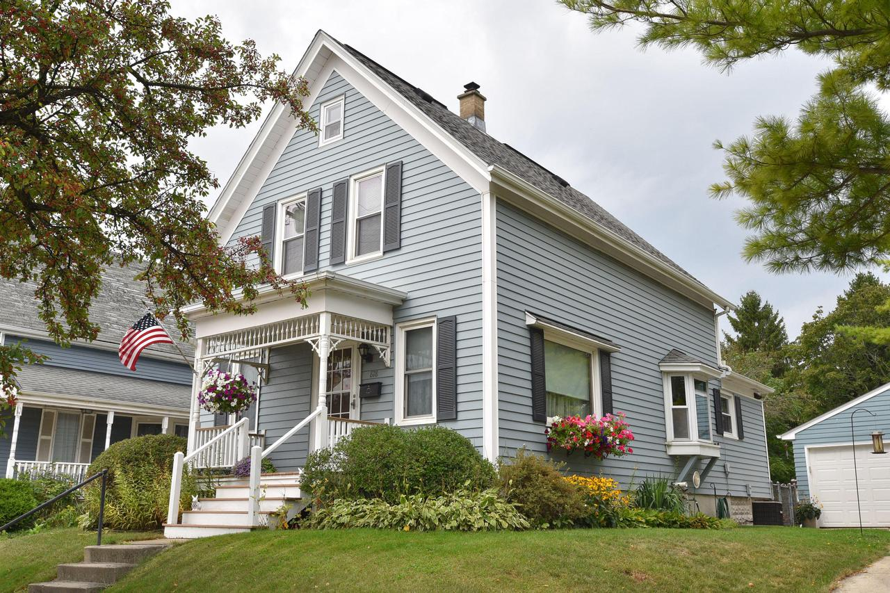 Come home to all the charm and character that this home has to offer, yet so many updates. Huge eat in country Kitchen with island and bayed window. Newer wood laminate flooring and tons of cabinets. Spacious Living Room and 4 nice bedrooms. You'll appreciate the beautiful fenced in back yard with all it's flowers, lots of room to roam and play! Updates include: windows 2009, garage doors & openers 2014, garage roof approx. 3 years, rubber roof on back section 2016, front porch 2016. This home is a true gem within walking distance of schools, church, and downtown Grafton! Well cared for and ready for you to move in.