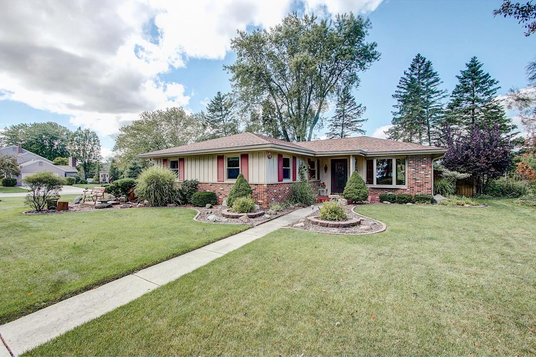 Location, location, location!!! This lovely 3 bedroom, 2 bath Ranch is situated across the street from the Lake Michigan bluff. It is in an ideal location of access to Upper Lake Park, walking distance to town, schools, and easy access to the Interurban Trail.  The kitchen has been updated with granite counter tops, new cabinets and appliances.  Hardwood floors throughout the kitchen and family room.  A large deck off the family room is perfect for entertaining. The fence surrounding the back yard provides privacy. The lower level is finished offering multiple options for its use.