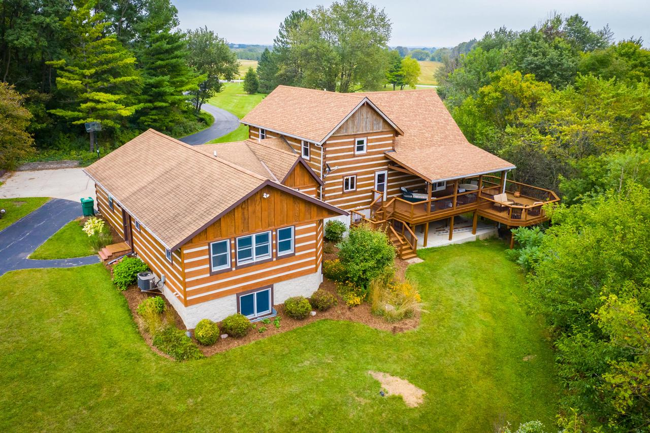 This custom hand hewn log home is something right out of ''Currier & Ives.''  Sitting on 10 private wooded acres, the outdoors man will love to hunt on this land when not spending time in either of the two-story outbuildings (40x36 & 47x22)! The home itself has been meticulously maintained and offers large spacious rooms, f/p, HWF's, first floor master suite with private bath and loads of closet space, a large second bedroom or home office can also be found on the first floor along with a mud room, separate laundry, walk in pantry and powder room. The second floor offers two additional bedrooms and full bathroom. The exposed LL is finished off with a rec room, family room, den, kitchenette and full bath!  A must see for anyone looking for a country life style.  SLINGER school district!