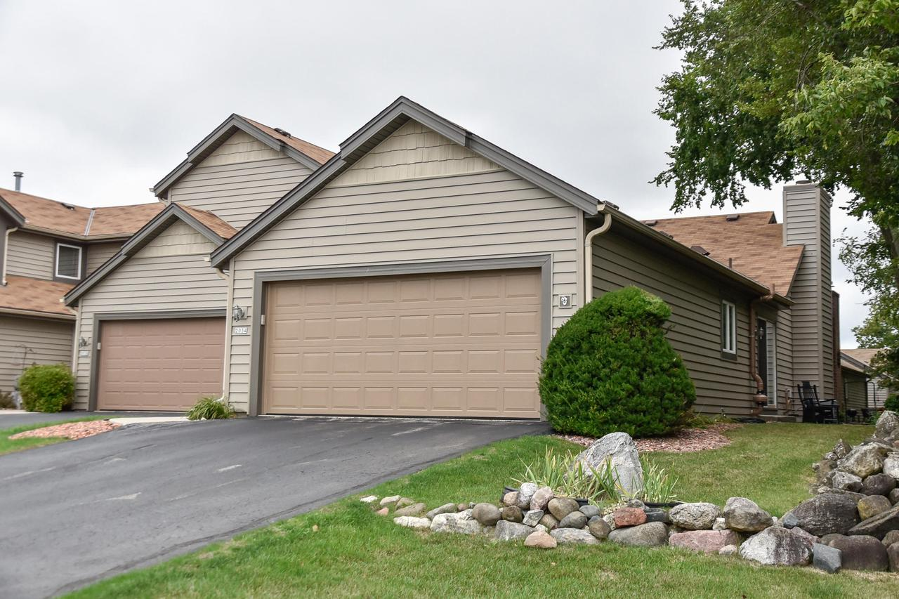 Spacious and inviting 2 Bedroom, 2 Bath Condo in conveniently located Grafton.Spacious kitchen with all appliances opens to eat-in area with island.Large great room/dining room combo is flooded with light and features vaulted ceilings and fireplace. Master bedroom with attached master bathroom and walk-in closet.Finished lower level rec room provides an extra space for entertaining.Private 2 car attached garage.Outdoor swimming pool included in condo fees!