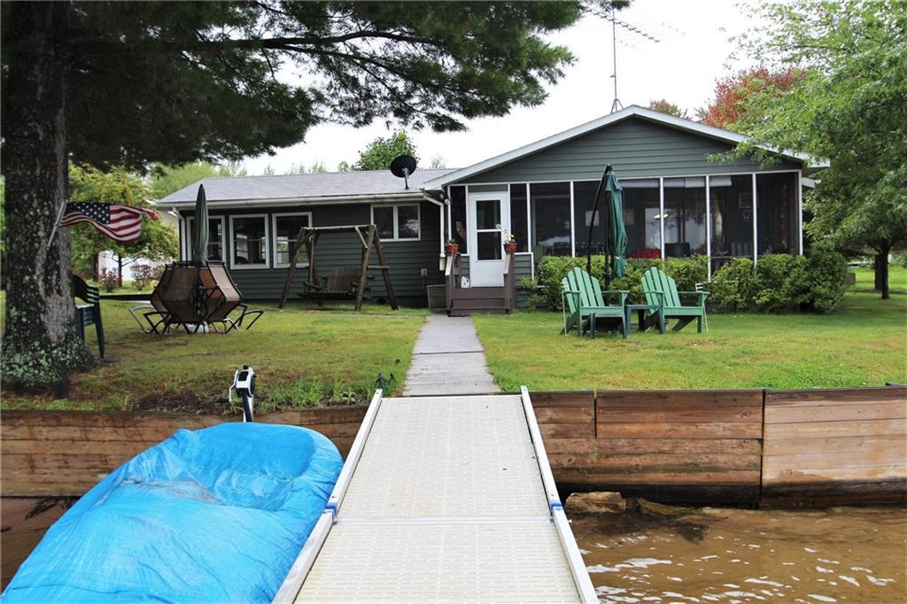 Cozy, well-maintained 2 bedroom bungalow overlooking beautiful Crooked Lake and walking distance to town. Perfect one-level living with 4-season porch and large 3-car garage. Low elevation and sandy frontage on full recreational lake! One-room bunkhouse for extra sleeping or privacy.