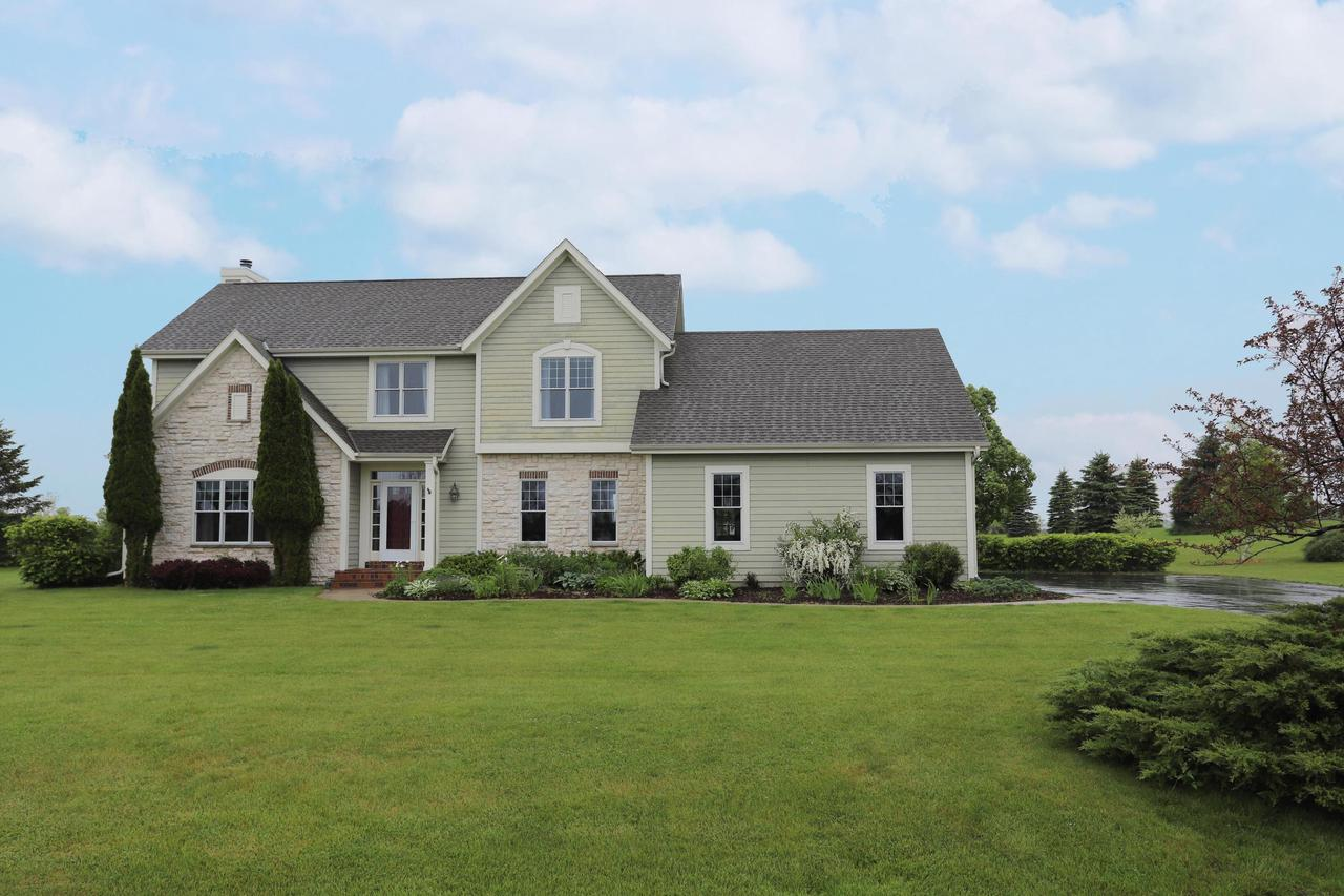 Impressive 4 Bedroom, 2.5 bath Colonial with gorgeous hardwood flooring, new carpet, fresh paint and beautiful views from every room. Newer SS appliances & handy granite island provide ease for entertaining.  Stunning formal dining room, family room, office/living room & half bath complete the main level.  Master suite includes master bath & separate walk in shower. 3 additional large bedrooms & full bath on upper. Lower provides a great get-away for kids with pool table and foosball. 3 car garage with shelving & workbench.  3.38 level acres is perfect for extreme outdoor fun.  Located just minutes from beautiful parks, Grafton schools, shopping, restaurants, hospitals & freeway.  Town of Grafton offers lower taxes, open space and convenience.  HOME WARRANTY provided by sellers!