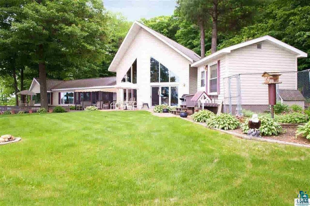 Great 3BR/4BA Lake Nebagamon home. Walk out to the level 234 ft. of sandy shoreline! Perfect for owner and entertaining with Owner and Guest Suites, two fireplaces, open staircase with vaulted ceiling. Jacuzzi hut and too many features to list at this perfect lake home.
