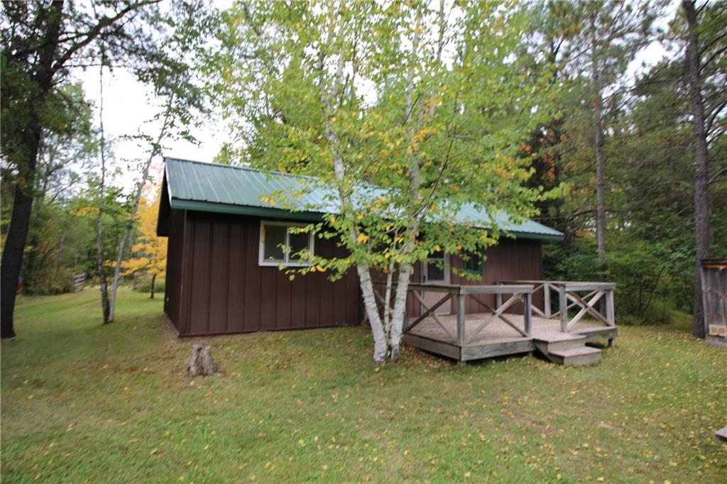 Privacy with 100 acres and a neat 1 bedroom cabin with knotty pine interior. The cabin is powered by generator, there is a bathroom with a shower, a water tank, a water heater. Some furnishings, a generator and a 500 gallon lp gas tank included. Hunting area heavily wooded with some rough trails and a drainage creek on the NW corner of the N 40 acres. Power is available at the east side of the property off the town road.  Excellent access to the property.