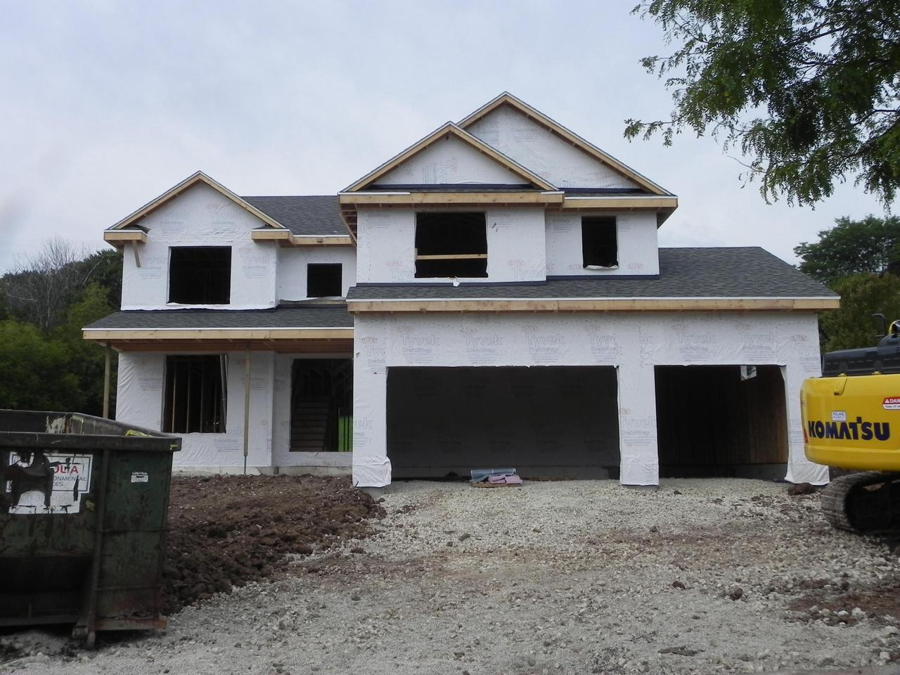New construction two story colonial with a open concept design. Enter the massive foyer with 1st fl offering 9 ft ceilings.  Free flowing kitchen/dinette and Gr room. Kitchen offers tons of cabinets, snack island, granite, walk in pantry and school desk.  Main level dining room or flex room + full mud room. The upper level has 4 bedrooms a upper laundry room.  Master suite with pitched ceilings, his/her walk in closets and master bath  with a walk in tile shower w/ 2 shower heads and double vanity  w/granite WOW!  Deck off of dinette, GFP Gr room + 3.5 car attached garage.  Lower offers radon system, full bath rough and exposed window to rear yard.   Maintenance  free ext. Waling distance to parks, schools and downtown Grafton.