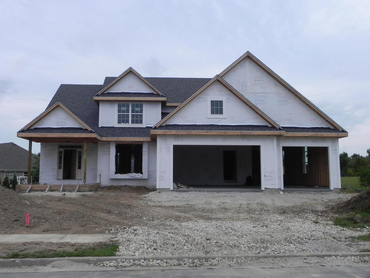 New Construction open concept four bedroom home with four car attached garage!   Huge living room with GFP and 9 foot ceilings 1st floor.  Working eat in kitchen with walk in pantry, granite counters, flush Island, tile back splash & tons of cabinets.  Main level formal dining room with Fr. doors.  Mud room offering lockers and full laundry room. large master bedroom with his/her walk in closets.   Master bath offering granite/Solid surface, double vanities, walk in tile shower with 2 shower heads! Three other spacious bedrooms and large closets.  Lower level has egress window system, full bath rough.  Country living on municipal sewer and water!!
