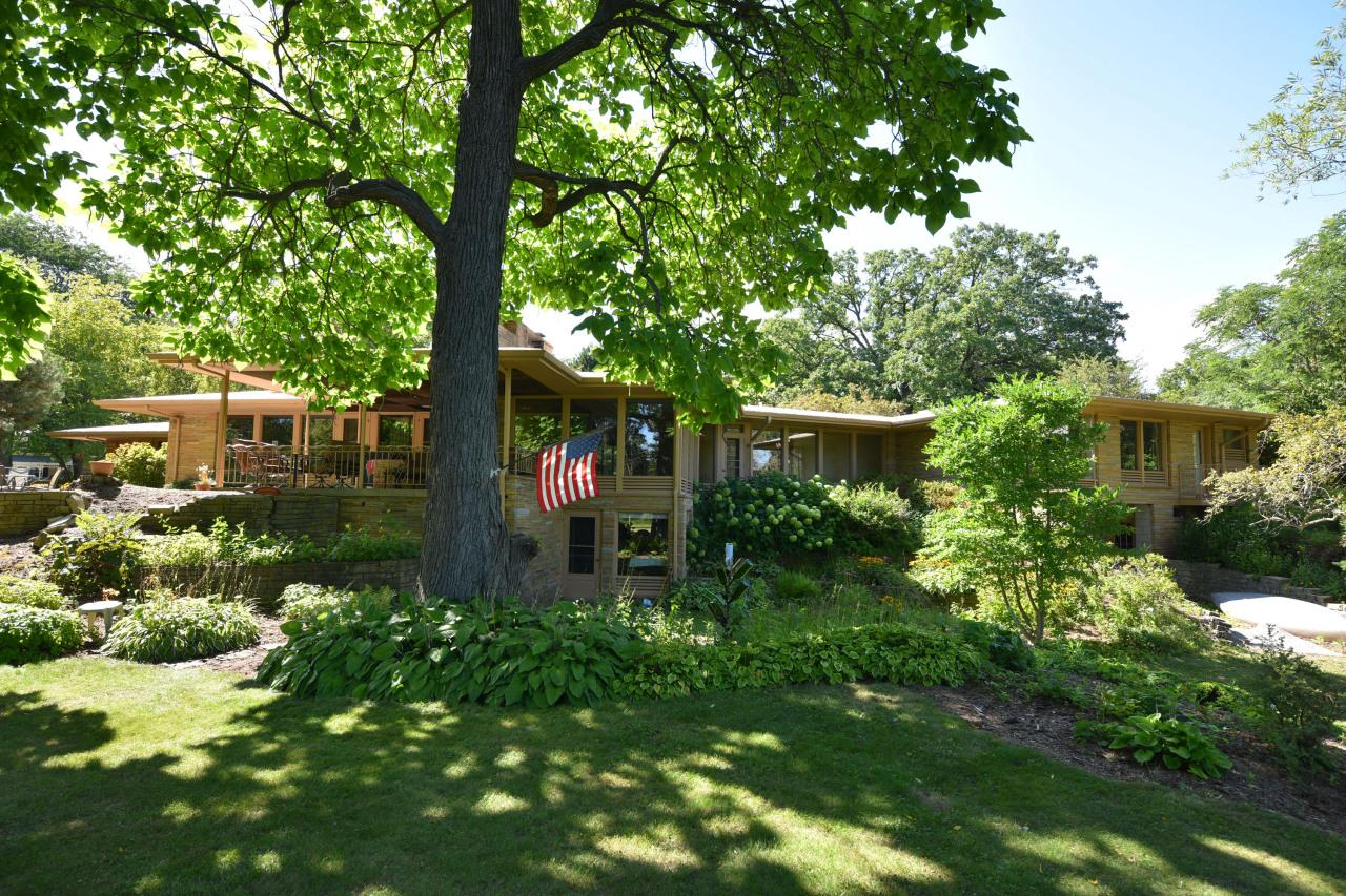 Looking to find unique mid-century modern ambiance? Then check out this very special hard-to-find home. Built to maximize the beautiful views along the Milwaukee River, with over 275 feet of frontage. Get that up north feel with private park-like setting on 1.3 acres, yet only walking distance to downtown Grafton. The lower walkout level is  designed to entertain, including its own pub room. The main living area is spacious yet comfortable and relaxing, designed to bring the outdoors in. Features two en suite master bedrooms. You will also enjoy the wonderful covered back porch area, great for morning breakfasts or just taking in nature. Living in your own private retreat, this home has the potential and space needed to make it your own.