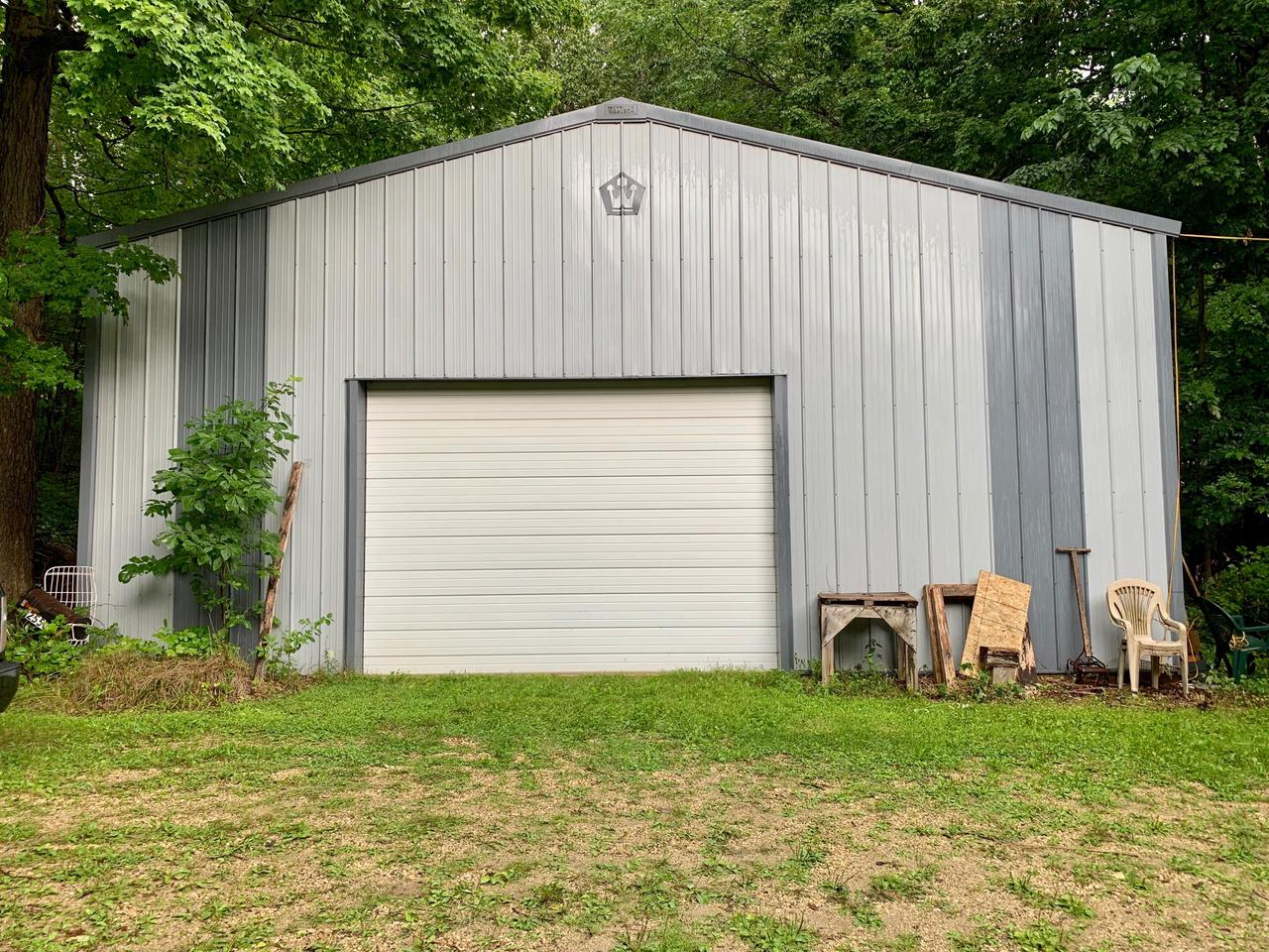 Bring your tool belt and ideas and build equity in this spacious 1-owner, 3BR 2Ba home! This raised ranch set on 4.43 rolling, wooded acres needs someone willing to dig into a project! Big LR features fieldstone natural fireplace leading to the beamed cathedral ceiling. The 35 x 70 FULLY INSULATED SHED is everyone's dream for storage and gives you a place to work while you bring back the house. Lot is fully wooded with rolling terrain and some paths for wandering. Trim a few trees and see for miles. Nice country drive to Hartford or Slinger OR beautiful drive heading south for work. This will make an excellent winter project for the handy person!