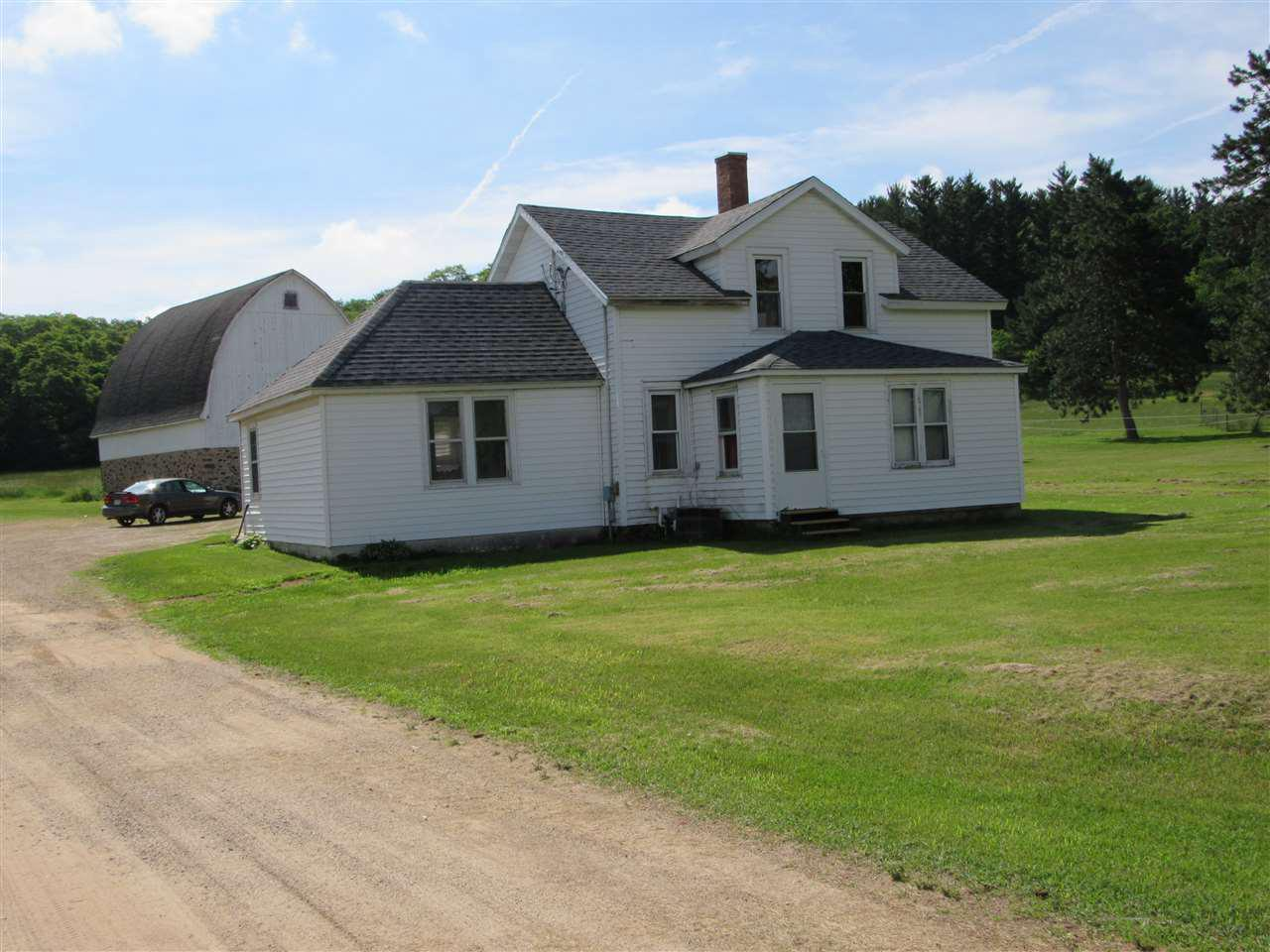 2 ACRE FARMETTE with multiple buildings just outside of Pardeeville. Old farmhouse with NEW well and upgrades to Electrical, Furnace, and Water Heater. Eat-in Kitchen with Dining Room plus Front and Rear Porches.  Cute 40 X 26 Barn , 2 Car 24x20 Garage, 46X40 Shop with 10X10 Roll-Up Door. Perfect opportunity for a business thru conditional use or rezone. Could also be a great place for the animals or support that special hobby. Many Other Miscellaneous Buildings. Tenant occupied.  More land may be available.  .