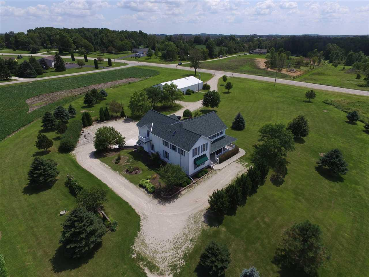 Elegant 3,300 sq.ft. 4 BR 2 1/2 bath 2 story on 6.9 acres of land near the Kettle Moraine Forest. Has great room w/wet bar, master BR w/balcony and Jaccuzi tub, numerous upgrades, plus a 45 x 90 outbuilding. $405,000. Up to an additional 45 acres available!