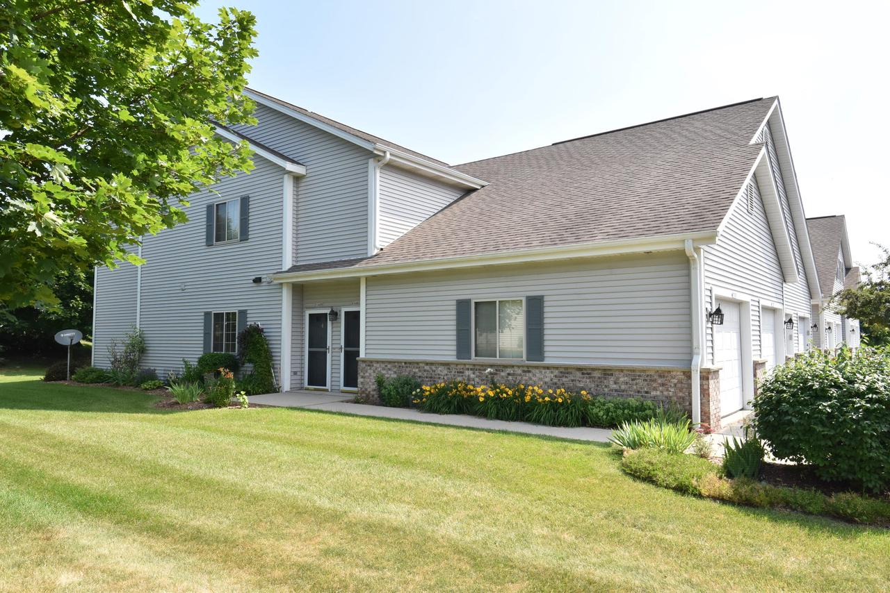 Only one owner has lived in this well-cared for 2st-floor condo. Located in one of the area's most desirable condo complexes this unit has an open kitchen, with new silestone counters, pendulum lights, and tile back splash. It flows to the dining area and great room, which has a gas fireplace with new tile surround and access to your private patio. Both bedrooms have newer carpet & walk-in closets, and both baths have brand new flooring and vanity tops.  The in-unit laundry area & storage area also have new flooring. This 1st floor unit is just a hop, skip & a jump from the inviting outdoor pool and clubhouse and enjoys a tree-lined view from the private patio. So start packing because you just found what you've been looking for. You've found home. (Dogs are not allowed in this building.)