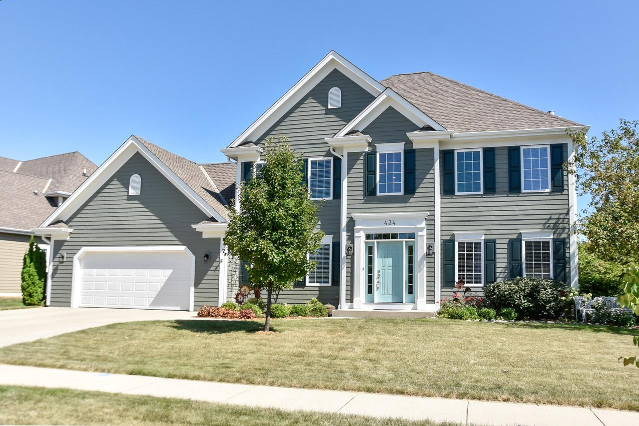 This showstopper colonial in Lone Oak is sure to please! Welcoming two story foyer opens to gracious dining room. Updated white kitchen with breakfast counter and sitting area flows into the great room with gas fireplace. Hardwood floors, 9 foot ceilings and oversized windows let the light shine in. Upstairs features a master oasis with walk-in closet and ensuite bath. 2 generous guest bedrooms and full bath. Lower level with egress offers rec room area, den and additional 3rd full bath. Den could be used for optional 4th bedroom. Stunning, professionally landscaped yard with pergola and room to play or entertain. Main floor laundry/mudroom is full of charm! This house has been meticulously cared for with a long list of updates. All of this plus Cedarburg schools! Don't delay!